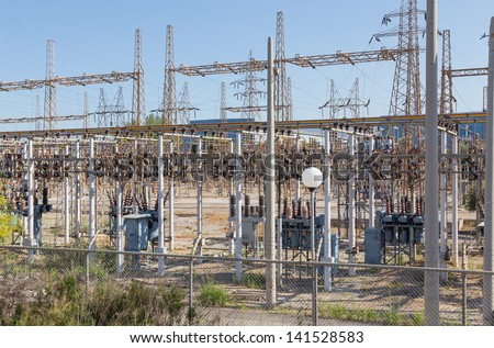 Electrical high voltage substation - stock photo