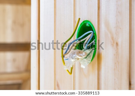 Electrical mounting box in  the wooden wall - stock photo
