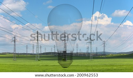 Electrical net of poles and lightbulb on a panorama of blue sky and green meadow  - stock photo