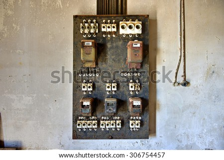 Electrical panel in the abandoned ghost diamond town of Kolmanskop in Namibia, which is slowly being swallowed by the desert. - stock photo
