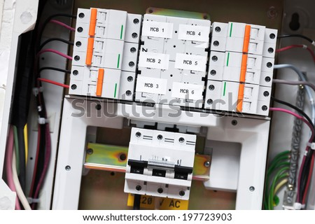 Electrical panel with automatic circuit breakers and wires - stock photo