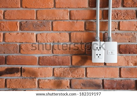 electrical plugs in wall outlet - stock photo