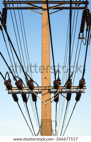 electrical pole with power line cables with blue sky - stock photo