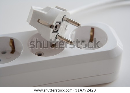 Electrical power strip with plug on it, electrical extension, power board - stock photo