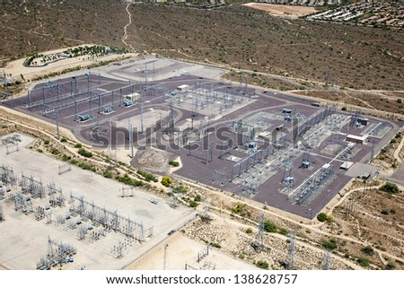 Electrical Power substation viewed from above in the Southwest desert - stock photo