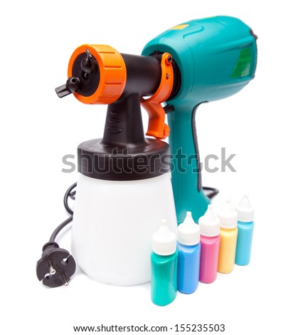 electrical spray gun for coloration, for color pulverization and  small bottles with color - stock photo