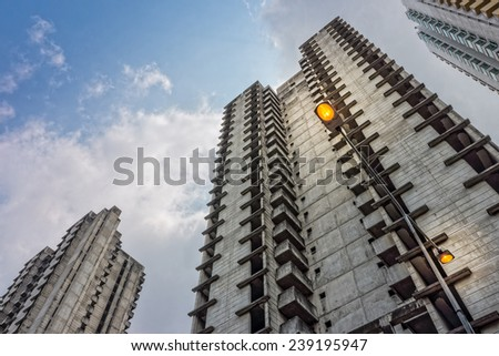 Electrical streetlamp with high rise building background - stock photo