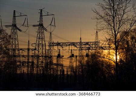 Electrical substation on the sunset background - stock photo