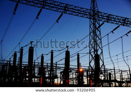 electrical substation silhouette on blue sky - stock photo
