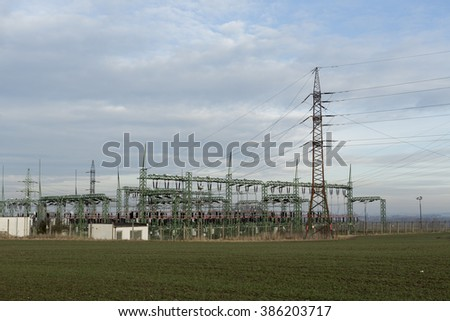 Electrical substation voltage. High voltage pylons, Power lines - stock photo