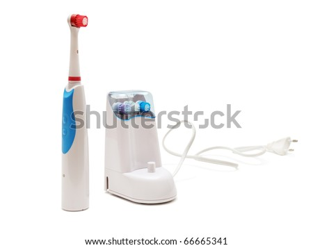 electrical toothbrush isolated on white - stock photo
