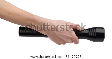 Electrical torch in hand - stock photo