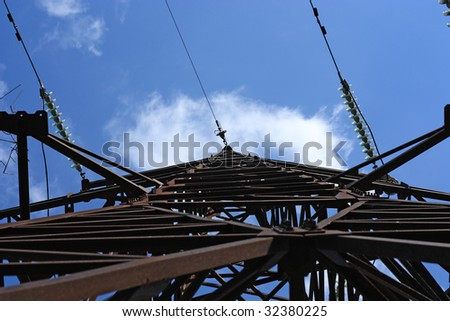 Electrical tower over blue sky - stock photo
