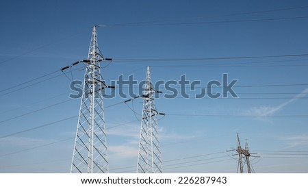 Electrical Transmission Towers. Electricity distribution. A line of electrical transmission towers carrying high voltage.  - stock photo