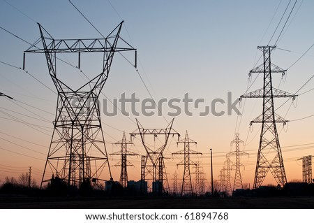 Electrical Transmission Towers (Electricity Pylons) at Sunset - stock photo