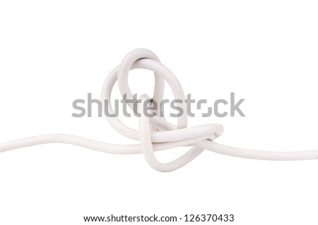 Electrical wire tangled in a knot isolated on white - stock photo