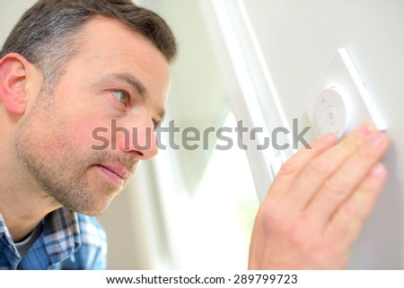 Electrician fitting an outlet - stock photo