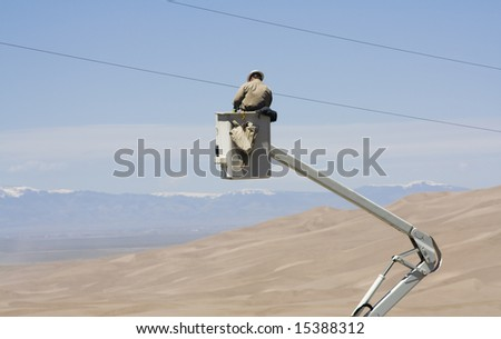 Electrician fixing power lines. - stock photo