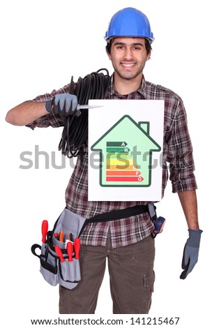 Electrician holding energy information board - stock photo