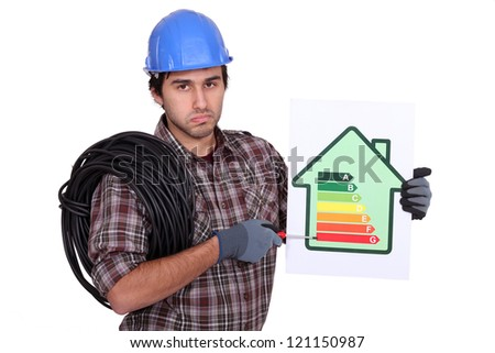 Electrician holding energy-rating information - stock photo