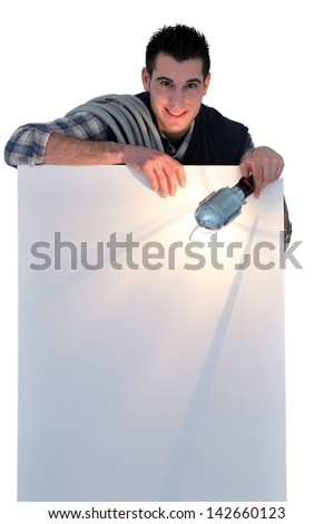 Electrician holding lamp - stock photo