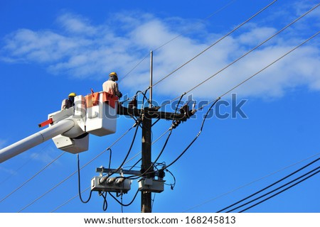 Electrician repair of  electric power system on  hydraulic platform  - stock photo
