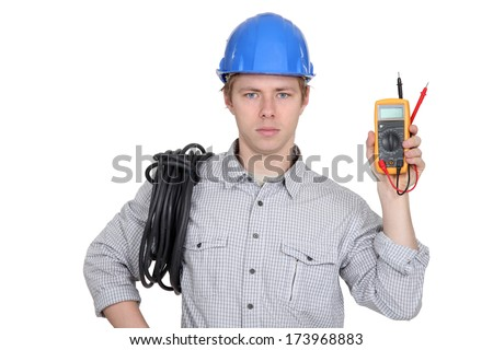 Electrician showing multimeter - stock photo