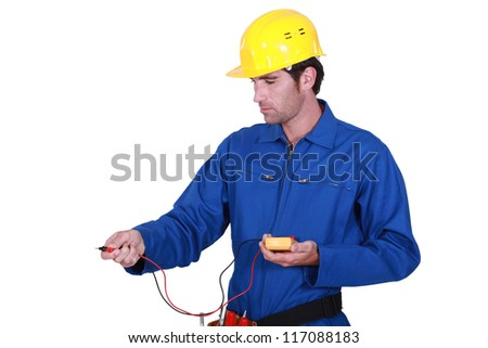 electrician taking reading - stock photo