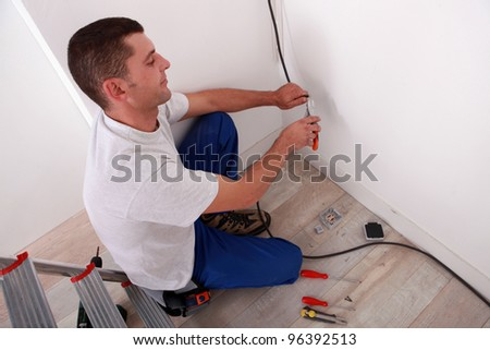 Electrician wiring a home - stock photo