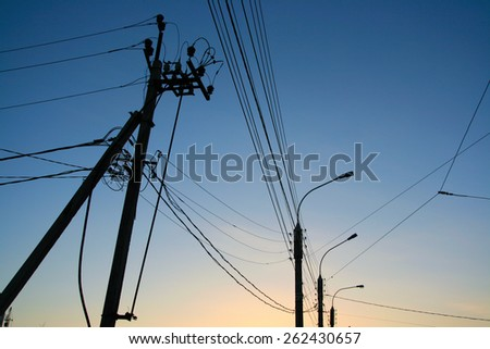 Electrician Wiring Cable and sunset sky - stock photo