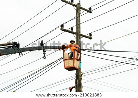 Electrician Wiring Cable on Power line - stock photo