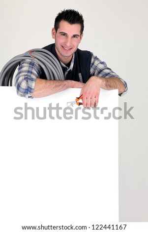 Electrician with advertising panel - stock photo