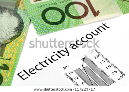 Electricity account showing increasing usage and greenhouse gas emissions, with Australian one hundred dollar bills. - stock photo
