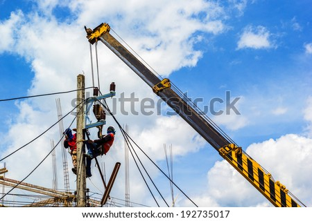 Electricity Authority on electricity post to repair a cable - stock photo
