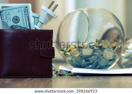 Electricity cost dollars - stock photo