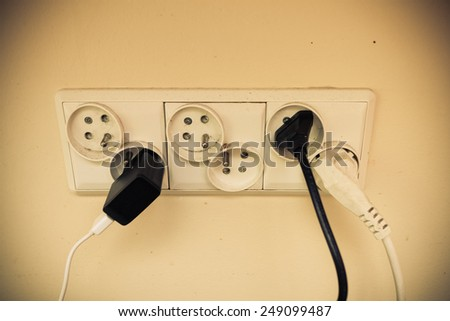 Electricity in house. Unclean like dangerous concept. Dirty electric plug in socket for power. - stock photo