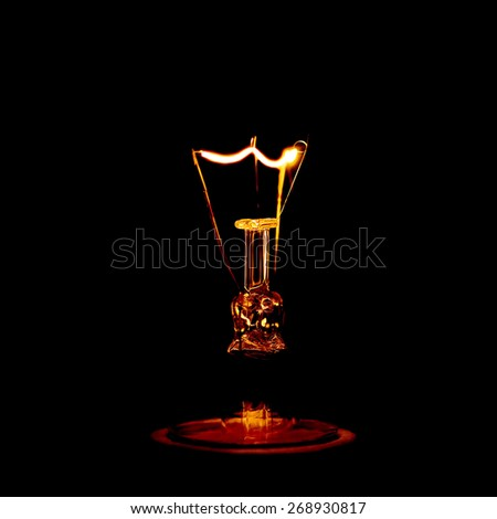 electricity lamp on  black background - stock photo