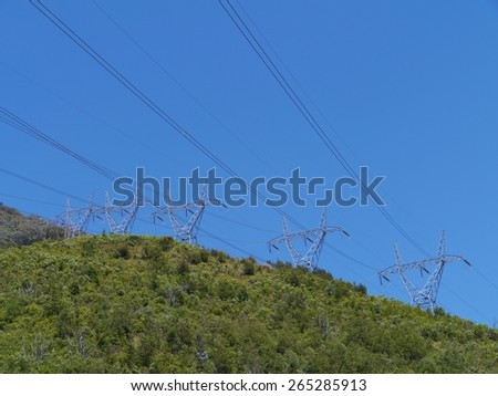 Electricity masts in the snowy mountains in Australia - stock photo