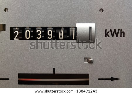 Electricity meter running fast - stock photo