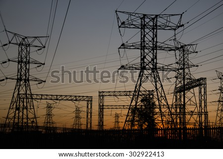 Electricity poles at sunset in Soweto, a township of Johannesburg in South Africa.   - stock photo