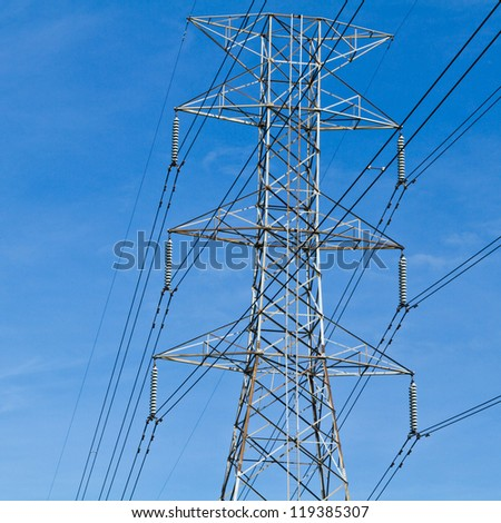 Electricity post in the blue sky. - stock photo