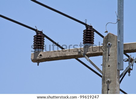 electricity post on blue sky in thailand. - stock photo