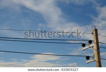 electricity post with cloudy and blue sky. - stock photo