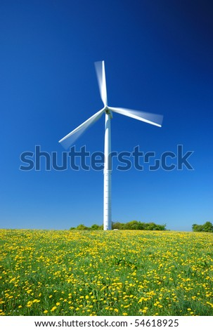 Electricity power wind generator pole against blue sky background - stock photo