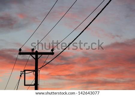 Electricity Pylon at dawn - stock photo