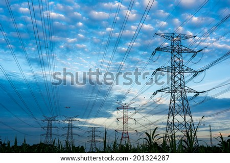 Electricity pylons and cable lines. Horizontal format - stock photo
