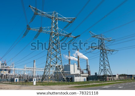 electricity pylons and power plant in Rotterdam, Netherlands - stock photo