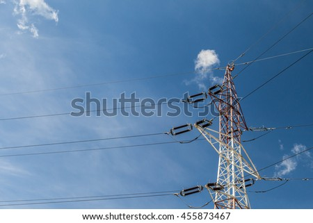Electricity pylons with blue sky background - stock photo