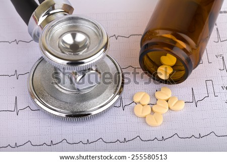 Electrocardiogram graph report with stethoscope on it - stock photo