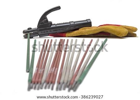 Electrodes for welding.holder for welding electrodes,welding leathers,welding electrodes - stock photo